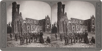 Artist Anonymous: Stereoscopic print: The curé tells Tommy how his church was destroyed by German shells.